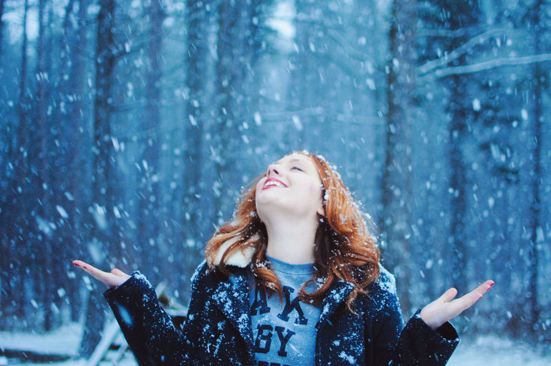 Winter Girl Carefree Casual Clothing Christmas Dance Day Focus On Foreground Forest Ginger Happy Holiday Horizontal Joy Laugh Leisure Activity Lifestyles Nature Outdoors Redhead Smile Snow Snowing Twenties Winter Woman Woods