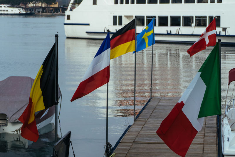 National flags on pier over river