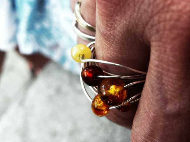 A close-up of an amber ring on a woman's hand. Accessories Amber Amber Ring Beauty Celebration Celebration Event Close-up Detail Fashion Fingers Focus On Foreground Hand Holding Jewellery Orange Person Ring Skin Tone Womans Hand Handmade For You