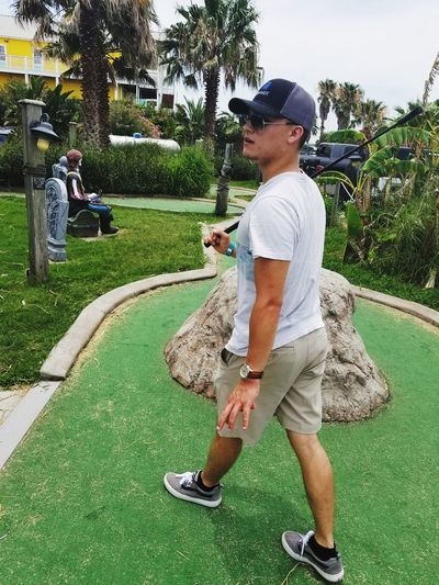 Grass Lifestyles Outdoors Leisure Activity Golf EyeEmNewHere EyeEm Selects Day One Person Palm Tree Park Golf Course Nature Streetphotography Passing By Galveston