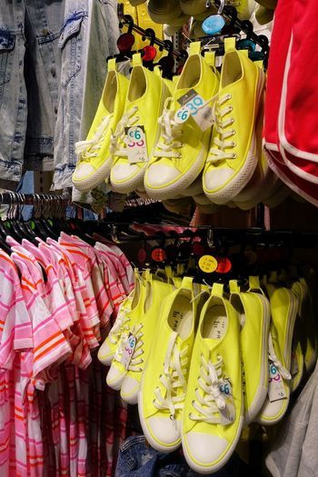 Retail  For Sale Choice Variation Market Multi Colored Market Stall Large Group Of Objects Side By Side Yellow In A Row Abundance Sale Business Shoe Primark Madrid SPAIN Bright Colors Sports Clothing Casual Clothing Sneakers Shoe Neon Color Retail Display