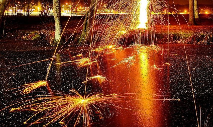 Long Exposure Motion Glowing Illuminated Blurred Motion Night Outdoors Backgrounds Firework Display Water 13 Mm 9 33 Circle First Eyeem Photo Elements Element Nature Nightphotography Multi Colored Color Swatch Travel Flames Ember