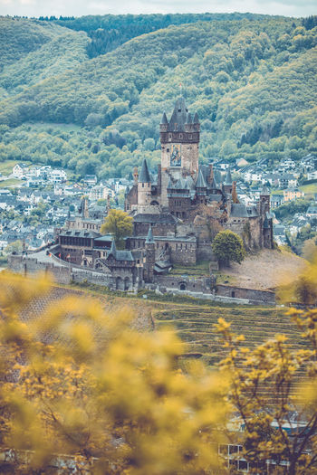 Cochem castle at the mosel valley, areal view, Cochem, Rheinland-Pfalz, Germany, 3rd of May 2019 Germany Mosel Tree Nature Plant Day No People Outdoors Architecture Cochem Cochem An Der Mosel Cochem Castle Castle Tower Historical Building Mideval Tree Old Travel Travel Destinations The Past Building Exterior Built Structure Building History