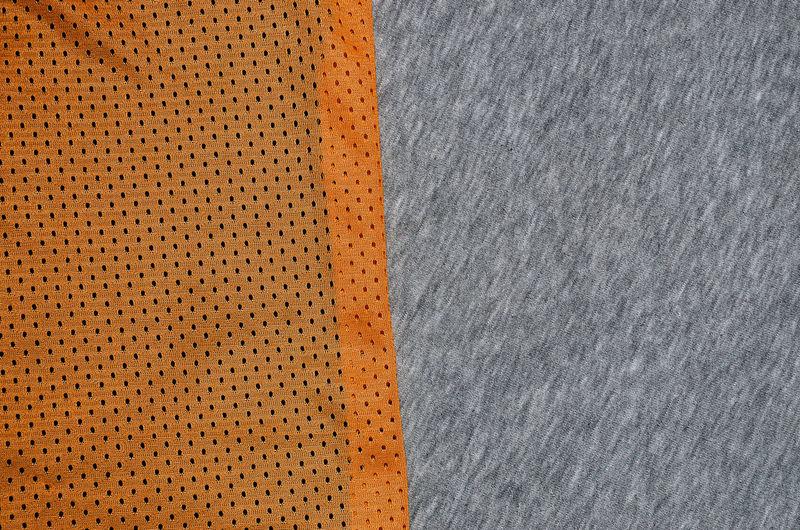 Full frame shot of orange and gray textiles
