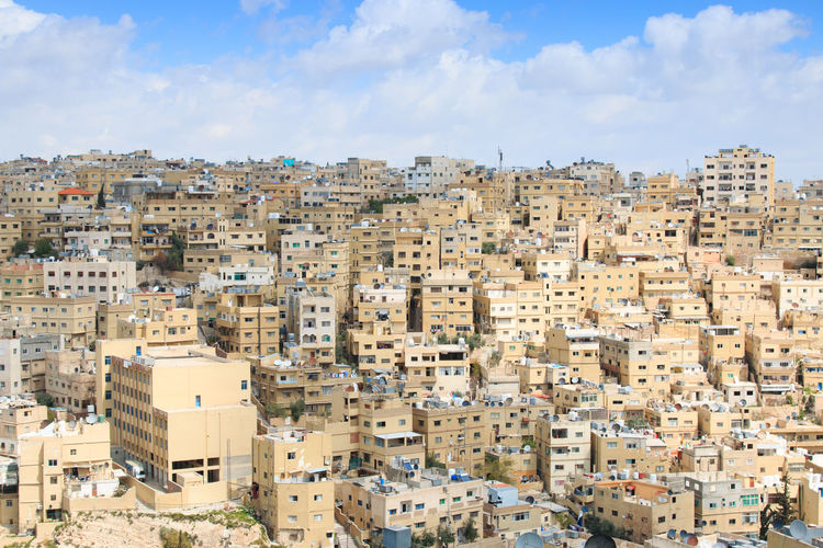 Amman, Jordan - March 22,2015: Panoramic view of Amman from one of the hills sorrounding the city Amman Architecture Building Exterior Built Structure City Cityscape Cloud - Sky Clouds Day Greek Heat Isis Jordan Residential Building Residential District Residential Structure Roman Ruins Safety Sky Summer Tea Tourists Town TOWNSCAPE