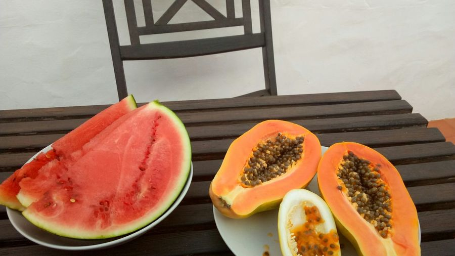 EyeEm Selects tropical fruits on the table Plate Fruit SLICE Food And Drink Freshness Healthy Eating Ready-to-eat Passion Fruit Maracujá Multi Colored Wood - Material Fruit Papaya Watermelon Food Stories