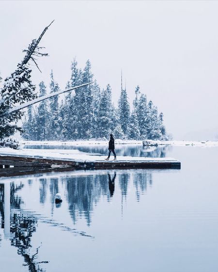 Frozen Reflections. Winter Snow Nature Cold Temperature Beauty In Nature Real People Water Tree Day One Person Scenics Outdoors Leisure Activity Frozen Men Lake Clear Sky Tranquility Lifestyles Full Length Fresh On Market 2018