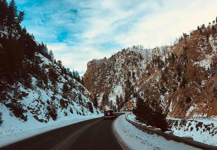 Road Amidst Mountains Against Sky During Winter
