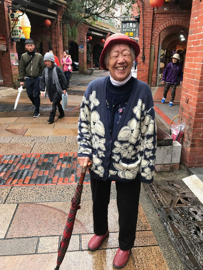 Adults Only Brick Building Brick Road Funny Moments Laughing Out Loud Old Town People Senior Woman Smiling