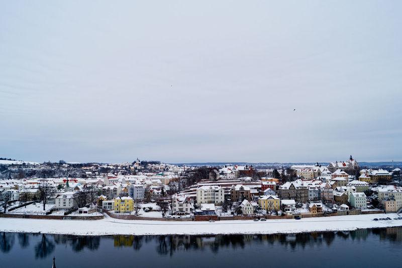 Meissen town by elbe river against sky