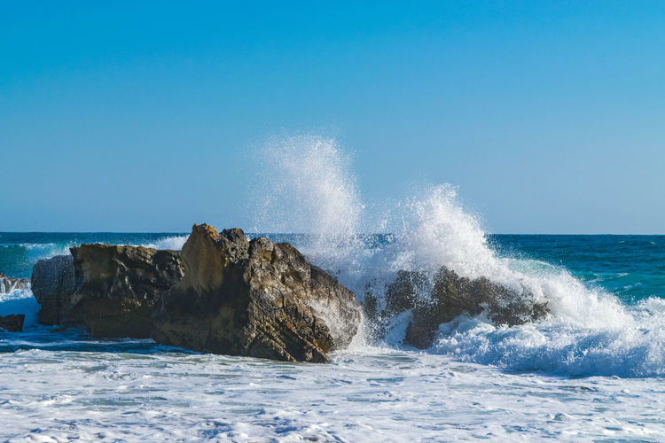 Big waves crashing on the rocks in Laguna Beach, California Beachphotography Big Waves Blue Sky Ocean Oceanspray Spray Waves And Rocks Waves Crashing Waves Crashing Sky Waves Rolling In Waves, Ocean, Nature The KIOMI Collection Blue Wave