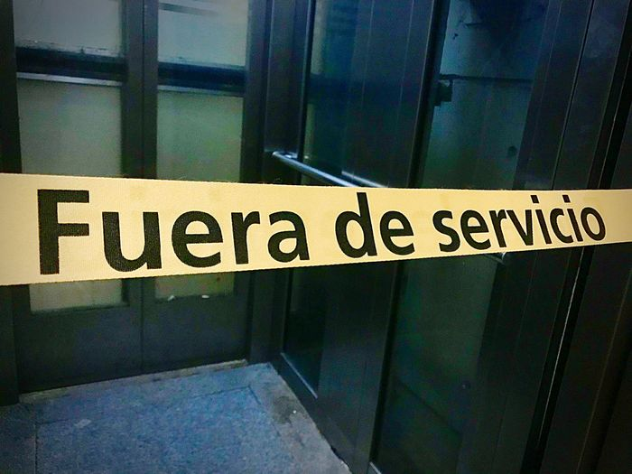 Fuera de servicio Out Of Service Fuera De Servicio Communication Text Western Script Sign Safety No People Security Information Protection Information Sign Capital Letter Architecture Guidance Warning Sign Indoors  Glass - Material Built Structure Message