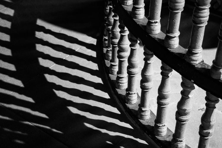 Shadow of bannisters on floor