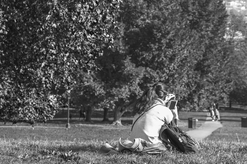 Relax Outdoors One Person Sitting Real People Person Day Horizontal Urbanphotography Urban Exploration Blackandwhite Tranquil Scene Black & White Grass Nature Horizontal One Woman Only Young Adult Sitting Freshness Tranquility