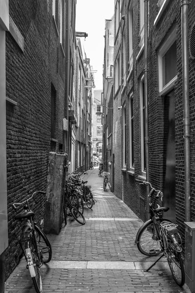 Amsterdam Amsterdam City Alley Architecture Bicycle Building Building Exterior Built Structure City Day Diminishing Perspective Direction Footpath Land Vehicle Mode Of Transportation Narrow Outdoors Parking Residential District Stationary Street The Way Forward Transportation