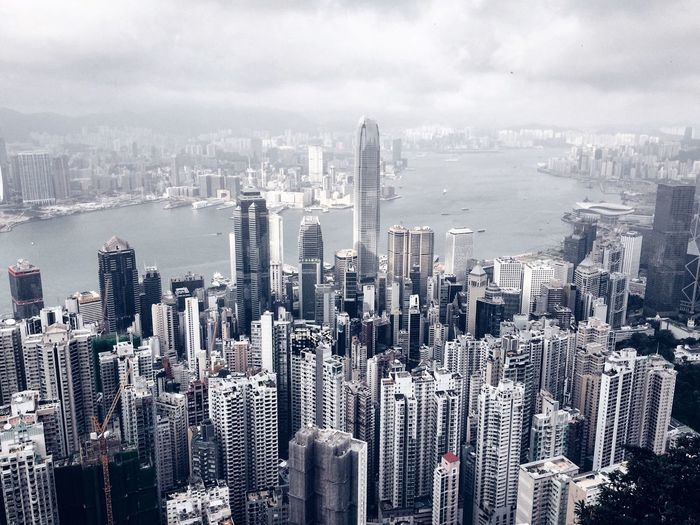City skyline against cloudy sky