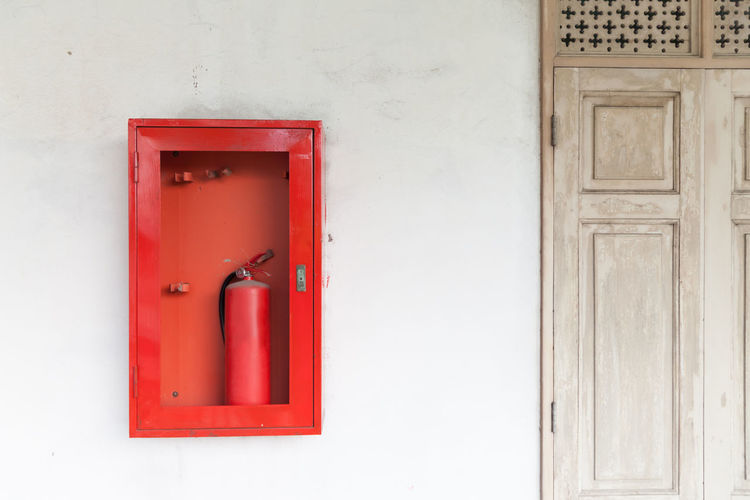 Red Safety Security Entrance Protection Door Wall - Building Feature No People Wood - Material White Color Architecture Emergency Equipment Building Exterior Cabinets Emergency Sign Extinguisher Hose Fire Object