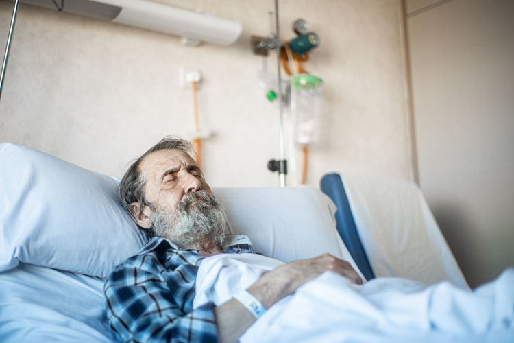 Midsection of man lying on bed