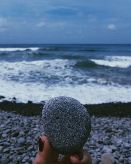 Rock Human Body Part One Person Human Hand Personal Perspective Holding Beach Sea Food And Drink Outdoors Sweet Food Water Indulgence Sky Close-up Day Leisure Activity Food Lifestyles Men Rock Wave Ocean