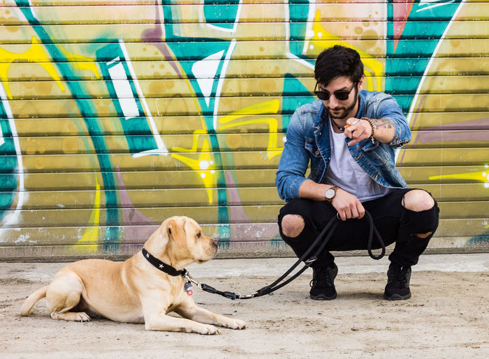 Shooting with a smart guy and his lovely dog BSide Color Portrait DogLove EyeEm Best Shots Graffiti Badboy Colorful Day Dog Dogandman Guyswithtattoos Hipster Ms4l People Sexyman Sexymen Tattoo Tattooman Pet Portraits