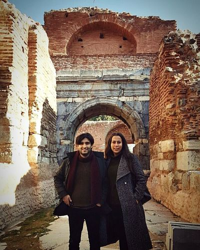 Two People Adults Only Portrait Looking At Camera Mid Adult Front View Building Exterior Adult Heterosexual Couple Architecture City People Togetherness Women Smiling Outdoors Brick Wall History Leisure Activity Happiness