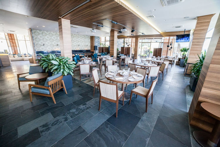 Hall of the restaurant. Interior Design. Tables and chairs Chair IndoorPhotography Interior Style Interior Views Plant Plants Room Room Decor Colomns Day Design Designing Furniture Furnitures Granite Hall Indoor Indoor Photography Indoors  Interior Interior Design Premises Rooms Table Tile