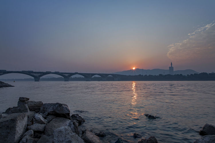 sunset Architecture Beauty In Nature Bridge - Man Made Structure Building Exterior Built Structure City Cityscape Horizon Over Water Nature Night No People Outdoors Scenics Sea Sky Sunset Water