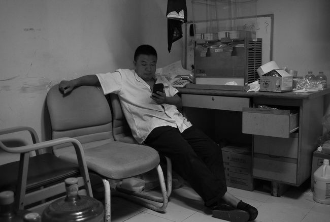Sitting Full Length Chair Architecture Relaxation Young Adult Casual Clothing Person Confidence  Leica M8 Voigtländer ULTRON 28mm F2 Tianjin China Your Design Story Voigtlander28mm Black And White Photography Black & White Black&white Black And White