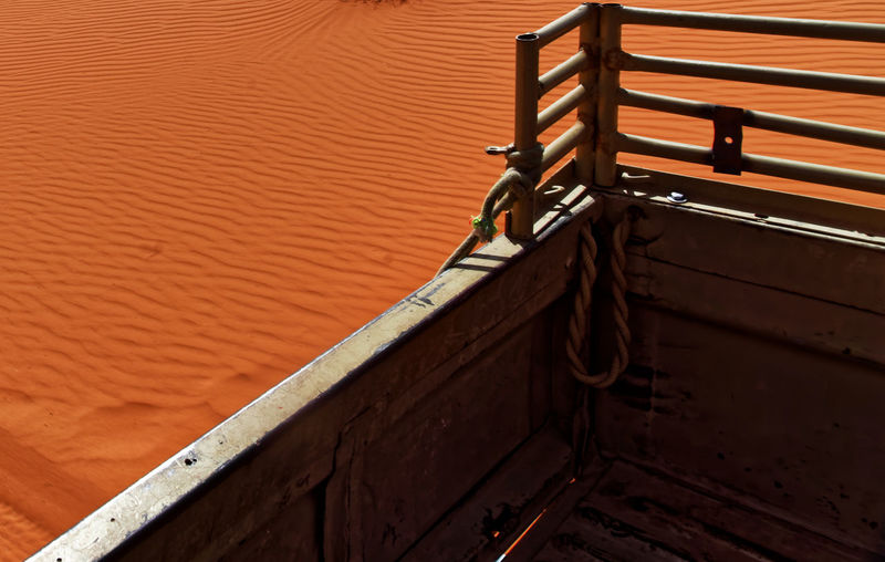 View from the platform of an off-road vehicle to the ripple marks in the desert sand of wadi rum