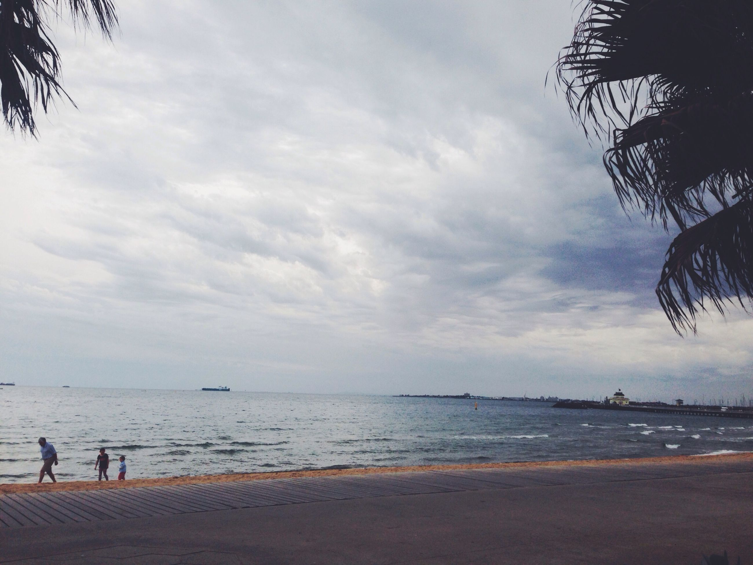 beach, sea, sky, water, horizon over water, cloud - sky, shore, cloudy, scenics, sand, tranquil scene, tranquility, beauty in nature, cloud, nature, tree, palm tree, incidental people, vacations