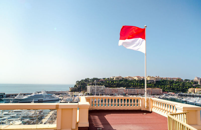 Flag on balcony against clear sky