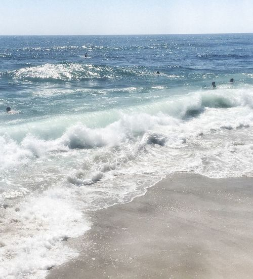 Southern California WindanSea Beach shades of blue water Enjoying Life Swimming With The Wave Shades Of Blue Water Daylight Shoreline Sandy Beach Vacation Spot And A Family Travel Destination