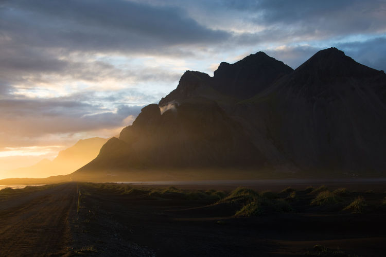 Dunes Iceland Shadows & Lights Stokksnes Travel Photography Traveling Beauty In Nature Black Sand Beach Black Sands Dunes Black Sands Island Landscape Mountain Mountain Range Nature Ray Of Light Vestrahorn Volcanic Landscape A New Beginning Capture Tomorrow