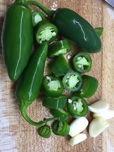 jalapenos Bunch Food Food And Drink Freshness Green Color Group Of Objects Healthy Eating High Angle View Indoors  No People Table Vegetable