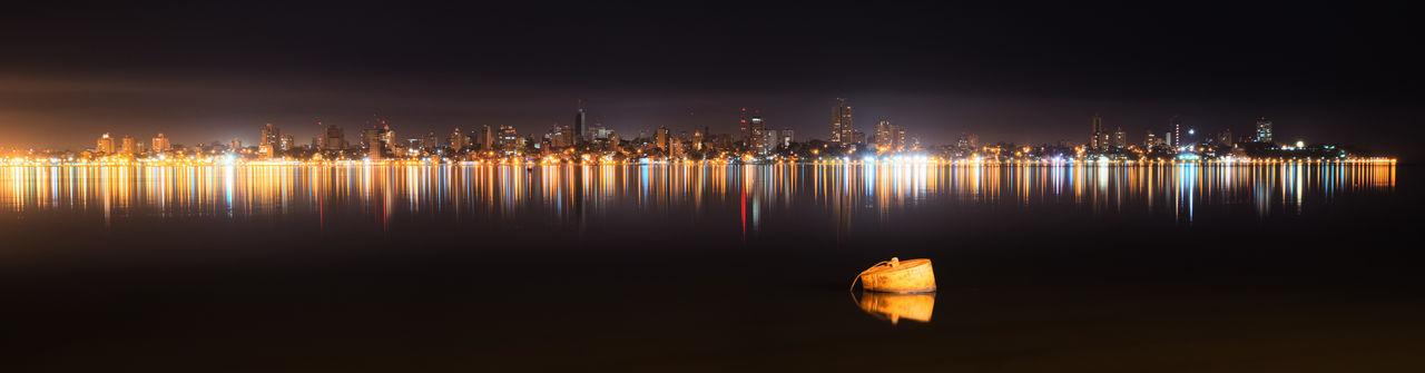 Posadas Buoy City Cityscape Illuminated Night Reflection Urban Skyline Water