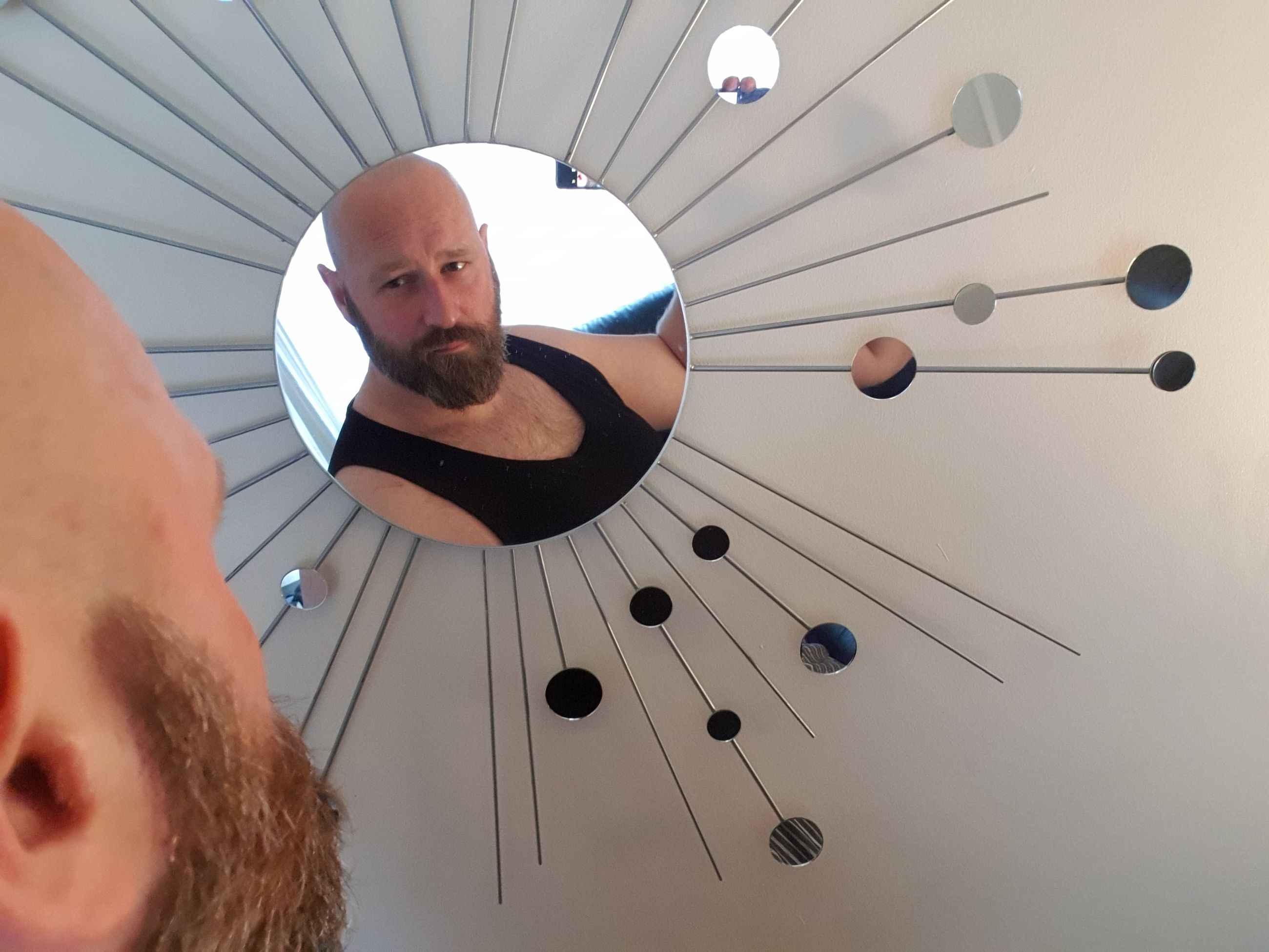 portrait, headshot, real people, one person, beard, leisure activity, indoors, facial hair, men, mid adult men, mid adult, lifestyles, males, adult, front view, young adult, young men, ceiling, human face, directly below