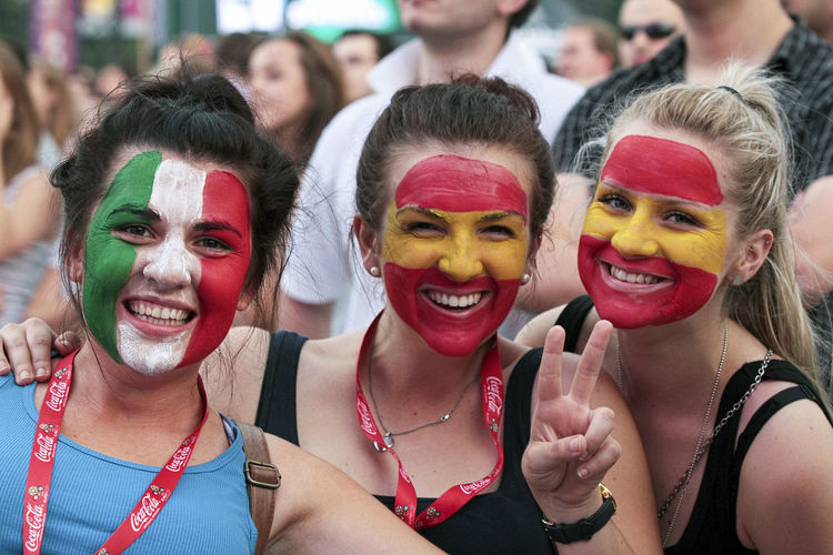 Arts Culture And Entertainment Celebration Cheerful Crowd Day Enjoyment European Championship  Face Paint Fan - Enthusiast Fans Football Fans Friendship Fun Happiness Headshot Leisure Activity Lifestyles Outdoors Performance Portrait Real People Smiling Stadium Togetherness Young Women