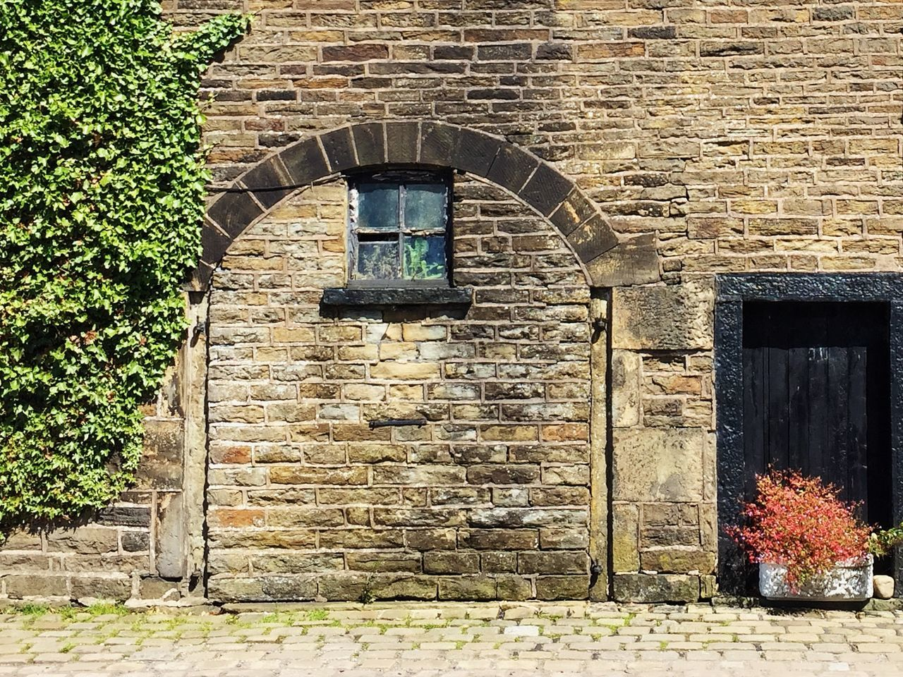 architecture, built structure, building exterior, building, wall, entrance, nature, plant, day, brick, no people, brick wall, door, house, window, arch, wall - building feature, flower, flowering plant, outdoors, stone wall