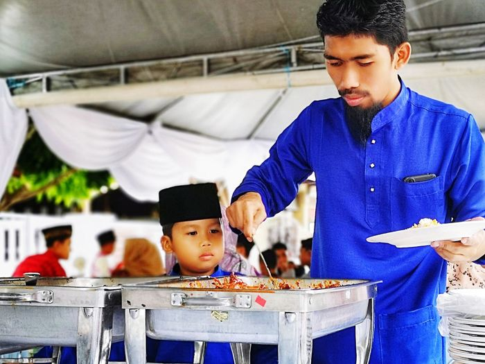 Looking take food Open House Selamat Hari Raya Attraction Malaysian Food Malaysia Scenery Aidulfitri Portrait Standing Front View Close-up Single Parent Children Thoughtful Family Bonds Parent Young Family Prepared Food Father Son