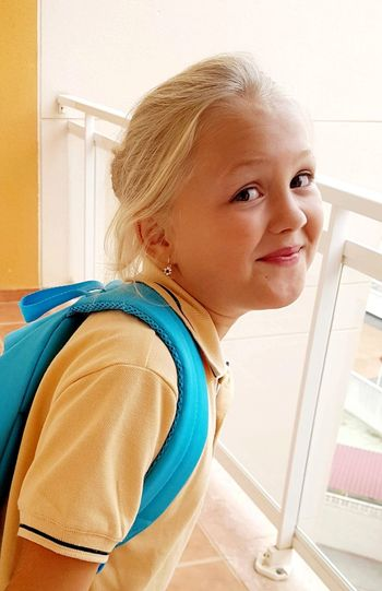 Portrait of smiling girl standing at home