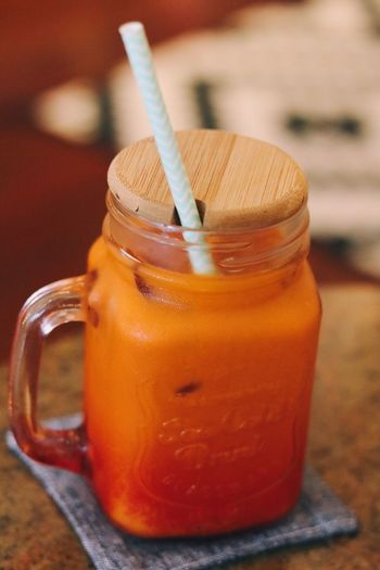 Mmmm, loving Thai Milk Tea alot, one downside: I won't be able to sleep at night 🌞 Drink Drinking Straw Food And Drink Refreshment Drinking Glass Table Jar No People Freshness Healthy Eating Close-up Indoors  Focus On Foreground Food Milkshake Iced Coffee Cold Temperature Blended Drink Frothy Drink Ready-to-eat Singapore Travel Travel Destinations Milk Tea Food And Drink EyeEmNewHere