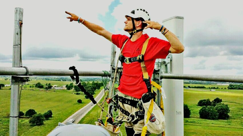 Sport Headwear Sports Helmet Sports Clothing Day Adult Only Men Young Adult Adults Only Outdoors Sky Competition People Men Competitive Sport One Man Only One Person Human Body Part Extreme Sports Sportsman On The Job Cell Tower Cellphone Tower Climbers Climbing