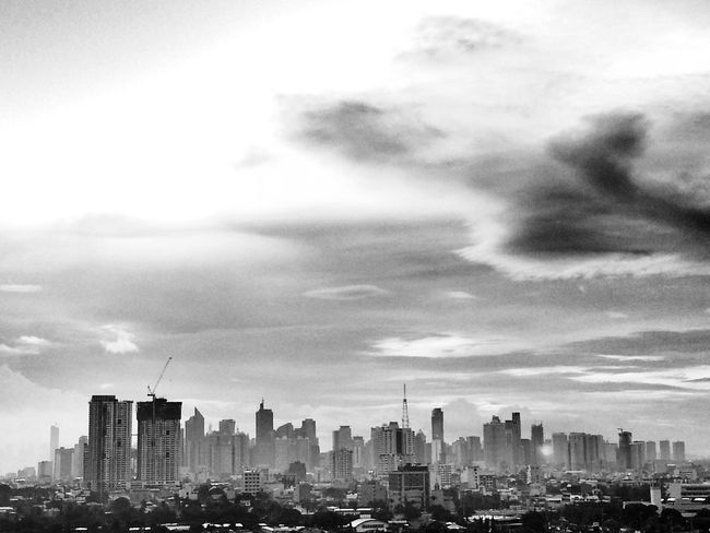 Cityscape Urban Skyline Building Exterior City Architecture Skyscraper Cloud - Sky Sky Downtown District Outdoors Travel Destinations Manila, Philippines No People Vertical Built Structure Day Miles Away
