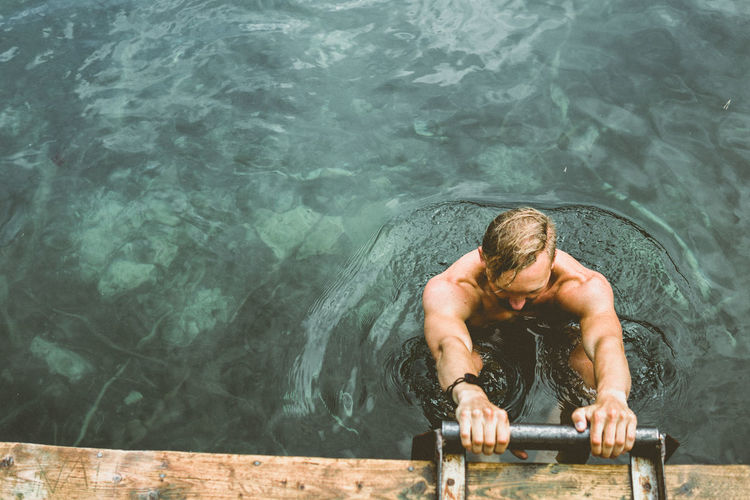 clear EyEmNewHere Beautiful Man Summertime Woods Swim Freedom Nature Lake Clear Water Water Muscular Build Athlete Shirtless Swimming Summer Men Exercising High Angle View