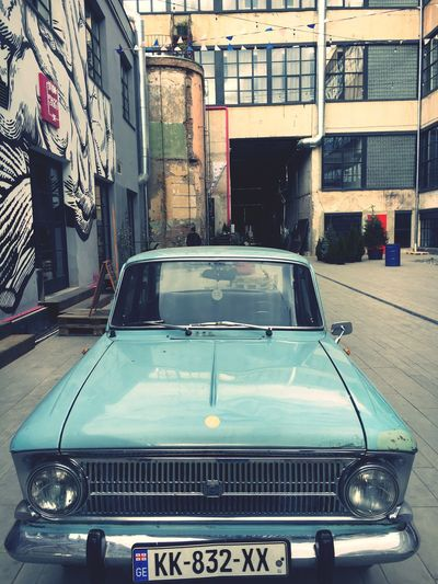 An old car in colour 🚙 Car Transportation Mode Of Transport Land Vehicle City Day Outdoors No People Number Plate My Photography Fabrika Tbilisi Old Car Vintage Old-fashioned