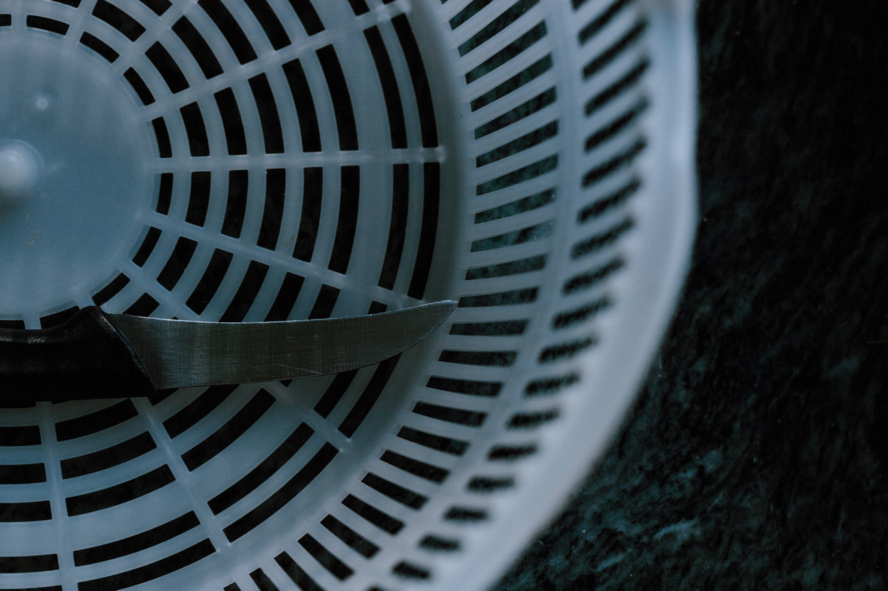 selective focus, close-up, pattern, no people, metal, focus on foreground, indoors, circle, shape, fan, machinery, electric fan, geometric shape, textured, still life, detail, design, day, directly below