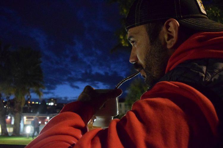 Close-up of man smoking hookah at dusk outdoors