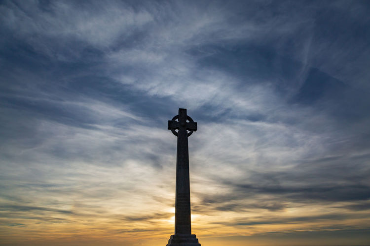 Tennyson Monument on the Isle of Wight, silhouetted at sunset Sky Cloud - Sky Low Angle View Sunset Nature Built Structure No People Architecture Silhouette Tower Tall - High Cross Outdoors Religion Statue Building Exterior Memorial Architectural Column Tennyson Down Tennyson Monument Isle Of Wight