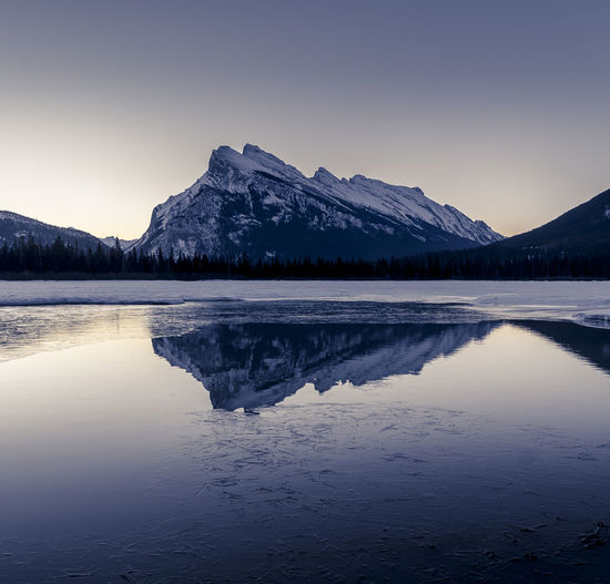 A reflected view of Rundle Mountain. Mountain Winter Mountain Peak Banff National Park  Banff  Alberta Snowcapped Mountain Mountain Range Beauty In Nature Rocky Mountains Canadian Rockies  Sunrise Reflection Rundle Mountain Vermillion Lakes Still Water Landscape First Eyeem Photo