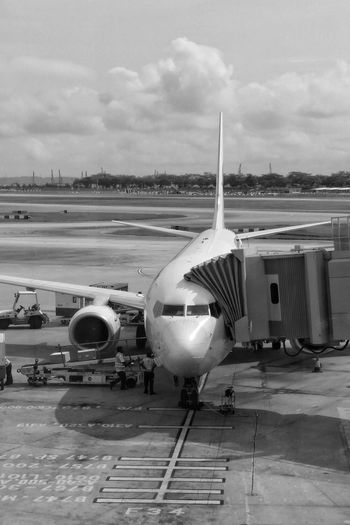 Aircrafts Departure Preparation  ApronDaily Life Black & White Black And White Blackandwhite Taking Photos View From The Window... Mode Of Transport Aircraft Eye4photography  EyeEm Gallery Showcase: February The Places I've Been Today TheWeekOnEyeEM Mobilephotography Changi Airport Singapore Let's Go. Together.